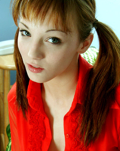Charly is a very cute teenage model who looks damned good in pigtails.